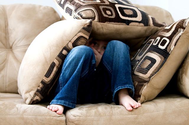 boy under pillows afraid - Dental Anxiety and Fear: Impact on Oral Health