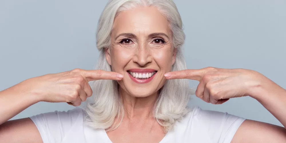 old woman smiling - Choosing the Right Dental Office in Jacksonville FL